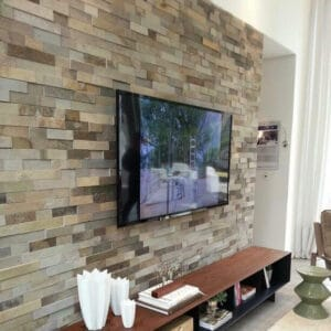 bricks wallpaper behind tv unit