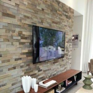 bricks wallpaper behind tv unit